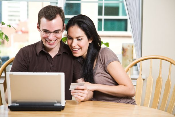 bigstock-Happy-Couple-Shopping-Online-5228367-610x407